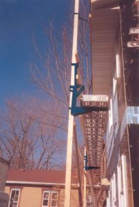 blue-pump-jack-side-of-house-689x1024